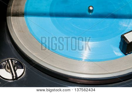 blue transparent flexi disc in old record player