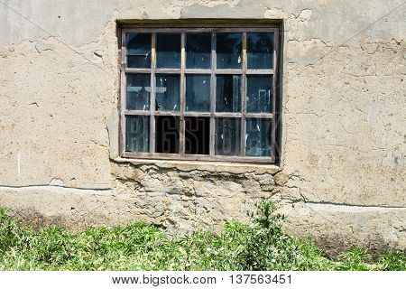 Window In Wall Of Abandoned Building