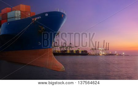 container ship in import export port of loading ship yard use for freight and cargo shipping vessel transport at twilight time.