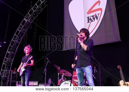 WANTAGH, NY-AUG 14: Singer Noah Hunt (R) and Kenny Wayne Shepherd of the Kenny Wayne Shepherd Band performs onstage at Jones Beach Theater on August 14, 2015 in Wantagh, New York.