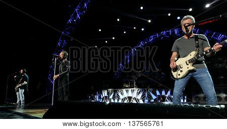 WANTAGH, NY-AUG 14: (L-R) Wolfgang Van Halen, David Lee Roth and Eddie Van Halen of Van Halen perform onstage at Jones Beach Theater on August 14, 2015 in Wantagh, New York.