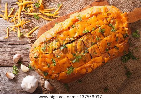 Bread With Cheddar Cheese, Garlic And Herbs Closeup. Horizontal Top View