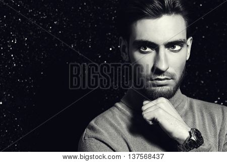 Portrait of a handsome young man. Men's beauty, fashion. Hairstyle.