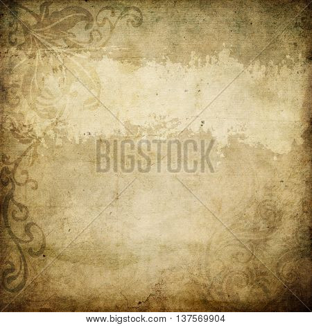 Aging dirty paper background with old-fashioned floral patterns. Vintage paper texture for the design.