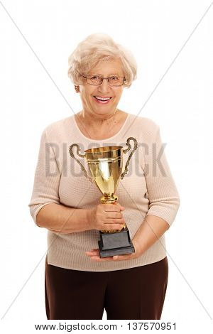Vertical shot of an elderly lady holding a golden trophy isolated on white background