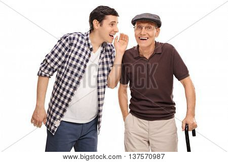Young man whispering something to his grandpa isolated on white background