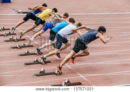 Chelyabinsk Russia - July 01 2016: men sprinters start at 100 meters during Ural championship in athletics