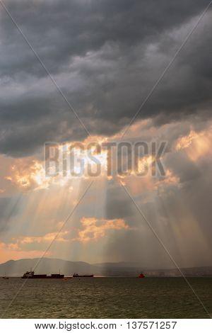 Solar beams breaking through clouds before the rain
