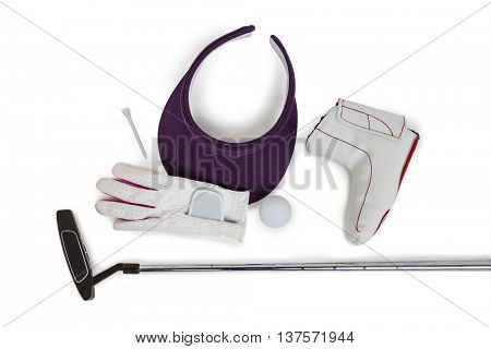 Close-up of various golf equipments on white background