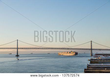 A Freighter Under Bay Bridge in San Francisco