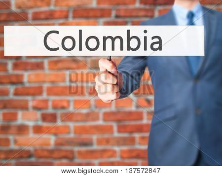Colombia - Business Man Showing Sign