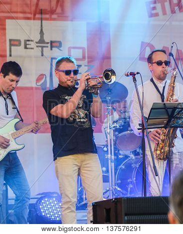 St. Petersburg, Russia - 2 July, Musicians in a blue spotlight, 2 July, 2016. Annual international festival of jazz and blues in St. Petersburg.