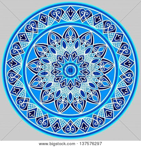 Drawing of a floral mandala in blue and white colors on a gray background