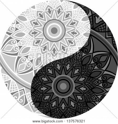 Drawing of a black and white mandala (round ethnic ornament) in shape of symbol yin yang