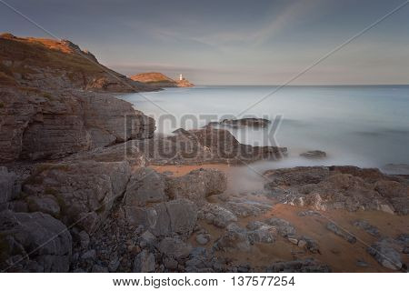 Bracelet Bay, over looking the Mumbles Lighthouse in Swansea Bay, South Wales