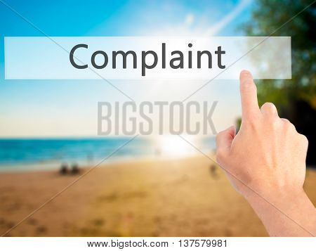 Complaint - Hand Pressing A Button On Blurred Background Concept On Visual Screen.