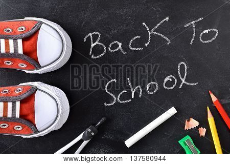 Back To School Written On A Blackboard With Tools