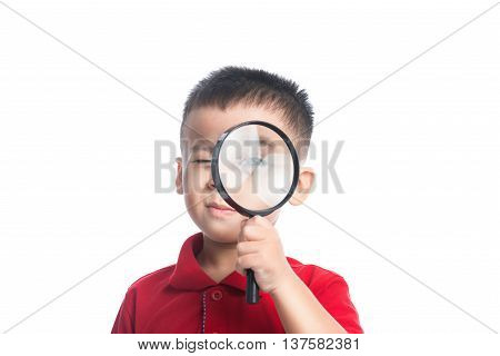 Portrait asian child looking through magnifying loupe