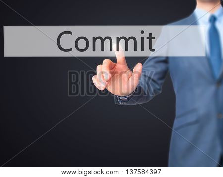 Commit -  Businessman Click On Virtual Touchscreen.