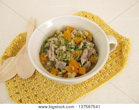 Soup with vegetables, barley and lentils in broth
