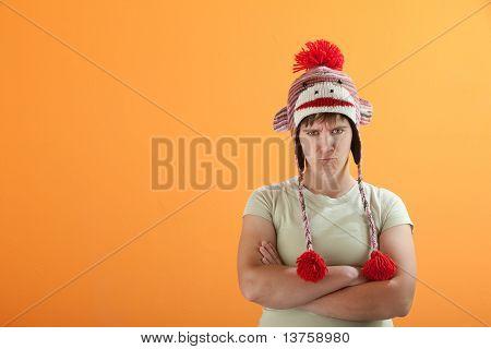 Upset Young Caucasian Woman In Monkey Cap