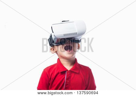 Amazed little asian boy looking in a VR goggles and gesturing with hands isolated on white background
