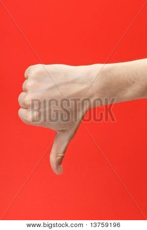 Disapproving gesture of a hand on red background