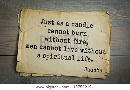 Buddha quote on old paper background. Just as a candle cannot burn without fire, men cannot live without a spiritual life.