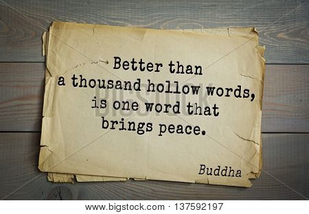 Buddha quote on old paper background. Better than a thousand hollow words, is one word that brings peace.