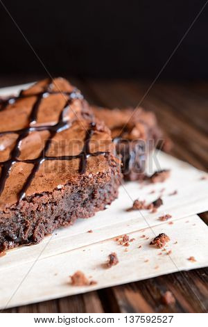 Classic chocolate brownies on a black background
