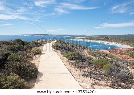 Pedestrian sidewalk to the Red Bluff lookout overlooking the Indian Ocean seascape on the coral coast in Kalbarri, Western Australia.