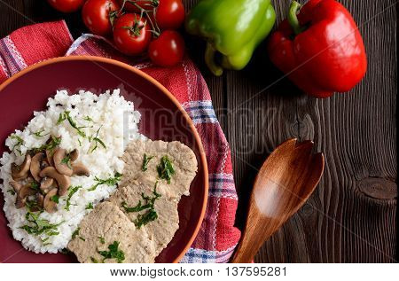 Pork loin fillets with rice and mushrooms