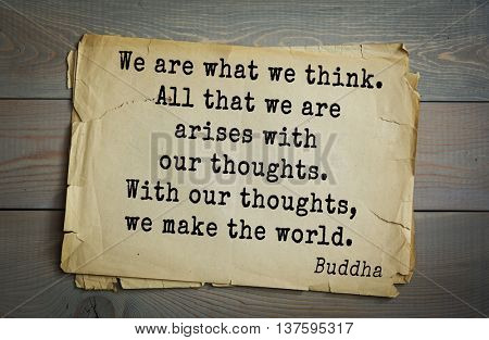 Buddha quote on old paper background. We are what we think. All that we are arises with our thoughts. With our thoughts, we make the world.