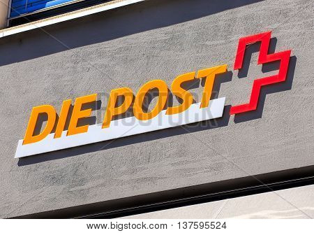 Aarau Switzerland - 7 July 2016: Swiss Post sign on the wall of a post office. Swiss Post a public company owned by the Swiss Confederation which provides national postal service for Switzerland it is the country's second largest employer.