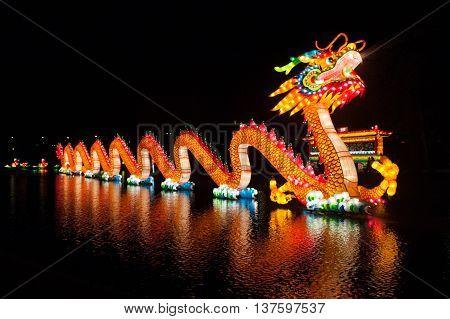 ROTTERDAM, NETHERLANDS, 02 FEB, 2014: Chinese illuminated dragon on the lake in Rotterdam China Lights festival 2013