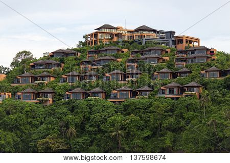 Bungalows on a hill Hotel of several separate houses located on different levels. Standing on the mountain near the sea in the jungle.