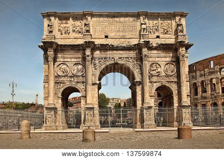 ROMA ITALY APRIL 7 2016 : Arco de Constantino (Arch of Constantine) and Colosseum. The arch was erected by the Roman Senate to commemorate Constantine victory over Maxentius