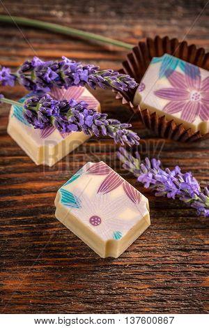 Lavender pralines on vintage wooden background, studio shot