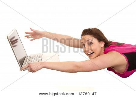 Woman Blowing Away From Laptop