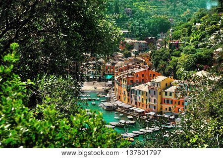 View from above on the bay Portofino with colorful houses and boats