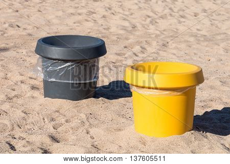 image of garbage containers on the sea beach