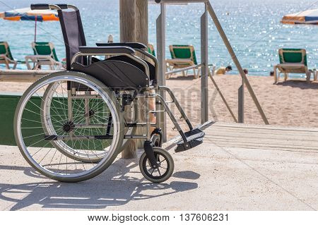 image of wheelchair on the beach background