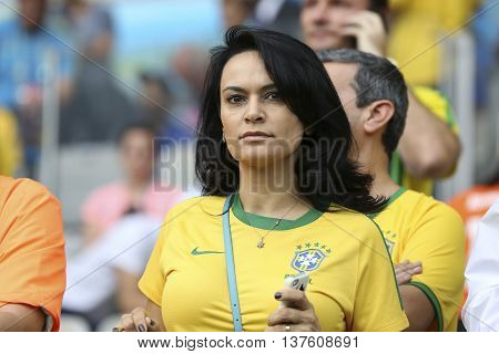 Belo Horizonte Brazil - july 08 2014: Women fan during the FIFA 2014 World Cup. Brazil is facing Germany in the semi-finals at Mineirao Stadium
