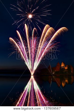 Fireworks in Trakai, Lithuania. Trakai Castle at night - Island castle in Trakai is a museum and a cultural center, Lithuania. Fireworks in Lithuania