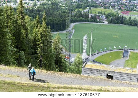 LILLEHAMMER, NORWAY - JUNE 27: Tourists enjoying the beautiful weather watch from above the Olympic ski jump on June 27, 2016 in Lillehammer, Norway. Lillehammer City Winter Olympics in 1994.