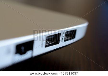 Two USB laptop slots closeup. Shallow depth of field.