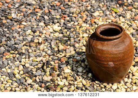 One clay brow pot on floor stone