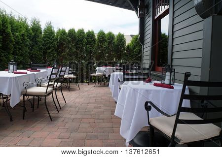 HARBOR SPRINGS, MICHIGAN / UNITED STATES - JUNE 20, 2015: The Depot Club and Restaurant offers outdoor patio dining in Harbor Springs.
