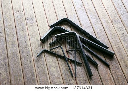 Set of Allen Keys on Wooden Background