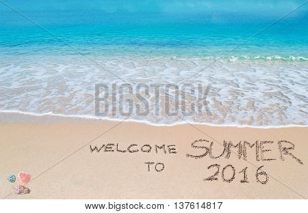 welcome to summer 2016 written on a tropical beach under clouds